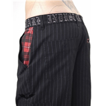 Short pinstriped trousers